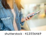 woman use of mobile phone | Shutterstock . vector #413556469