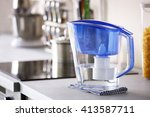 water filter jug with napkin on ... | Shutterstock . vector #413587711