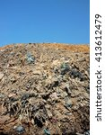 Small photo of Household waste and industrial garbage contaminates soil and groundwater at Bali's largest landfill site in Suwung, Bali, Indonesia. The site is vulnerable to leachate infiltration and tidal invasion.