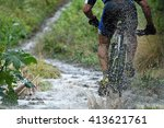 Mountain Biker Driving In Rain...