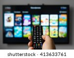 male hand holding tv remote... | Shutterstock . vector #413633761