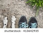 Stock photo dog s paw feet next to the owner friendship 413642935