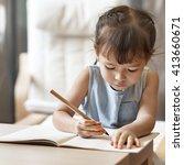 cute little girl writing... | Shutterstock . vector #413660671