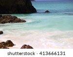 Ocean Wave Splashes On Sea Roc...