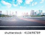asphalt road and modern city | Shutterstock . vector #413698789
