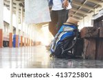 backpack and hat at the train... | Shutterstock . vector #413725801