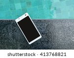 smartphone put on edge the pool.   Shutterstock . vector #413768821