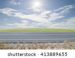 asphalt road with green grass ... | Shutterstock . vector #413889655