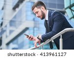 businessman looking at phone in ... | Shutterstock . vector #413961127