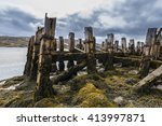 Old Jetty With Seaweed At The...