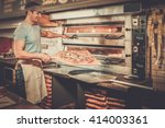 handsome pizzaiolo making pizza ... | Shutterstock . vector #414003361