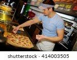 handsome pizzaiolo making pizza ... | Shutterstock . vector #414003505