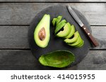 Sliced Avocado With Knife On...