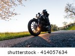man sat on motorcycle on the... | Shutterstock . vector #414057634