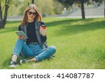 girl sitting on the grass with... | Shutterstock . vector #414087787