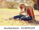 girl sits resting in a park on... | Shutterstock . vector #414094105
