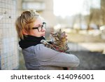 Girl In Glasses With A Cat In...