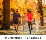 young friends jogging at the... | Shutterstock . vector #414125815