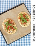Small photo of Tarte flambee, an alsatian pizza, with tomatoes and arugula