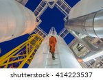 engineer climb up to oil and... | Shutterstock . vector #414223537