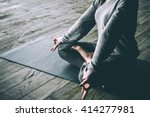 young woman meditates while... | Shutterstock . vector #414277981
