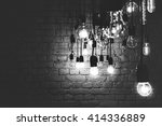 incandescent lamps on a brick... | Shutterstock . vector #414336889