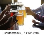 friends drinking beer in pub | Shutterstock . vector #414346981