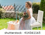 beautiful young bride on a lawn ... | Shutterstock . vector #414361165