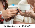 young and old women holding... | Shutterstock . vector #414386401