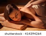 young woman at spa massage | Shutterstock . vector #414394264