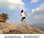 Young Woman Trail Runner...