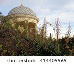 Rotunda in city park, blooming yucca and shrubs against the sky - stock photo
