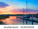 Sunrise Over A Docked Sailboat...