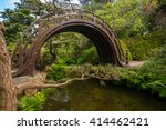 A Wooden Moon Bridge In The...