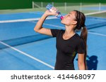 Stock photo healthy tennis player thirsty thirst quenching drinking health sports drink water plastic bottle 414468097