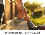 a the parent holds the hand of... | Shutterstock . vector #414493105