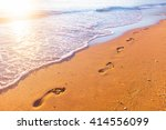 beach  wave and footprints at... | Shutterstock . vector #414556099