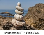 pebbles stacked up in a pyramid ... | Shutterstock . vector #414563131