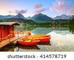 red boats moored at wooden... | Shutterstock . vector #414578719