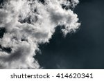 Dark Night Sky With White Clouds