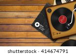 vinyl record and player on... | Shutterstock . vector #414674791