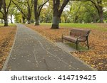 A Wooden Bench Along The Path...