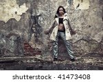Young woman in a ruined building. Contrast colors. - stock photo