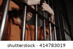 man in jail behind bars  ...