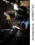 worker wearing a protective... | Shutterstock . vector #414805765
