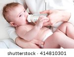 the baby in diapers eating... | Shutterstock . vector #414810301