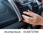 closeup of hand adjusting the... | Shutterstock . vector #414873784