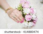 bride holding her flowers | Shutterstock . vector #414880474