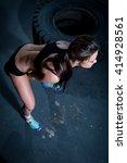 muscular woman doing kettle... | Shutterstock . vector #414928561