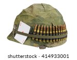 Small photo of US Army helmet Vietnam war period with camouflage cover and ammo belt , dog tag and amulet - playing card ace of diamonds